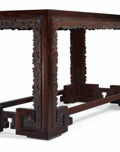 A CARVED ZITAN CORNER-LEG TABL