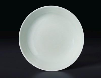 A SMALL CELADON-GLAZED DISH