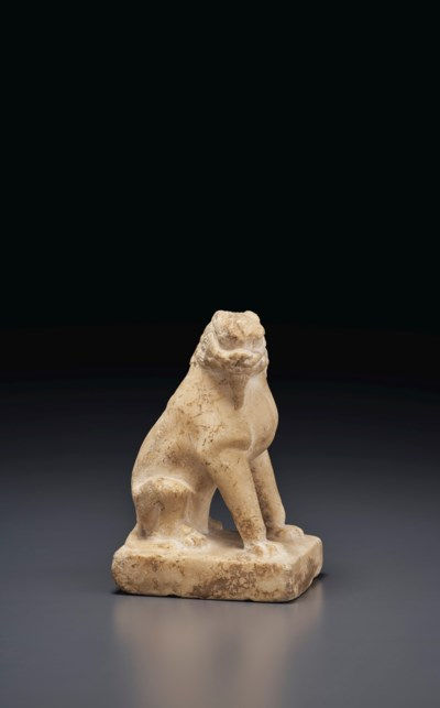 A SMALL WHITE MARBLE FIGURE OF