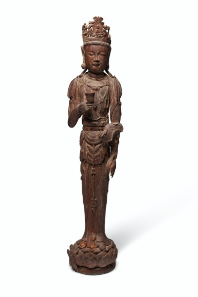 A CARVED WOOD STANDING FIGURE