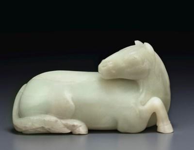 A GREENISH-WHITE JADE FIGURE O