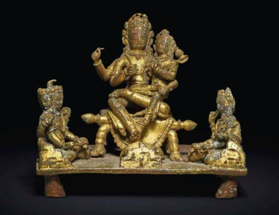 A GILT-COPPER GROUP OF SHIVA A