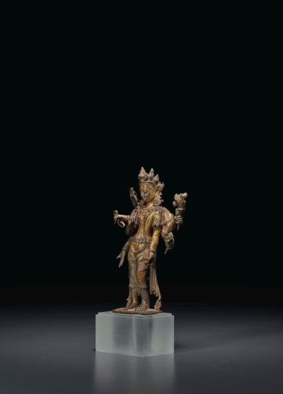 A GILT-COPPER FIGURE OF AMOGHA