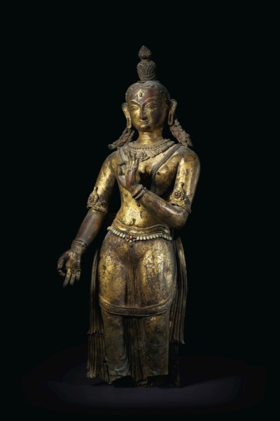 A GILT-COPPER REPOUSSE FIGURE