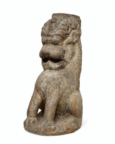 A LARGE GRANITE LION-FORM PILL