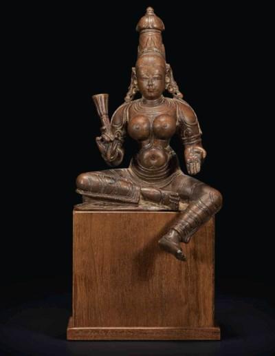 A BRONZE FIGURE OF BHUDEVI