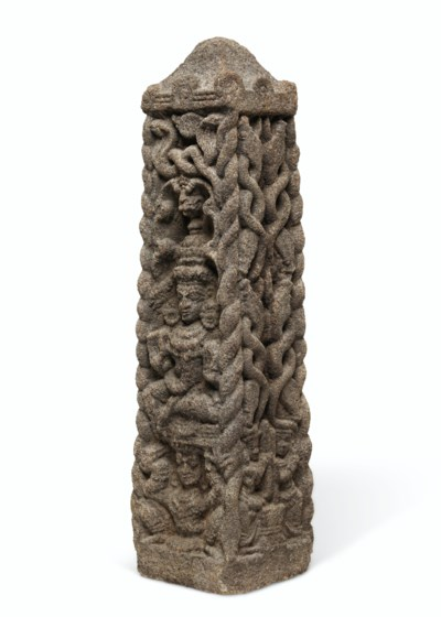 A GRANITE PILLAR WITH A YAKSHA