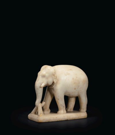 A WHITE MARBLE FIGURE OF AN EL