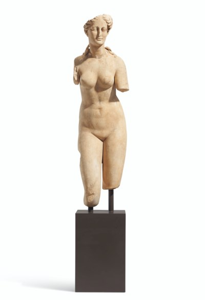A WHITE MARBLE FIGURE