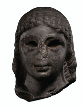 AN EGYPTIAN BASALT FEMALE PORTRAIT HEAD