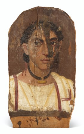 AN EGYPTIAN PAINTED WOOD MUMMY PORTRAIT OF A BOY