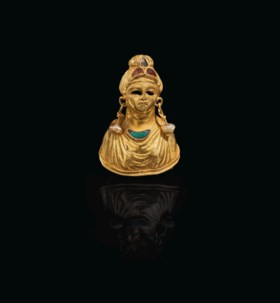 A BACTRIAN GOLD, GARNET PEARL AND TURQUOISE FEMALE BUST
