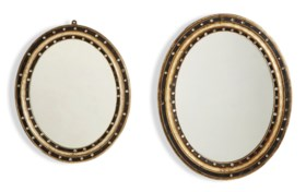 TWO IRISH VICTORIAN GILT AND PARCEL-EBONIZED MIRRORS
