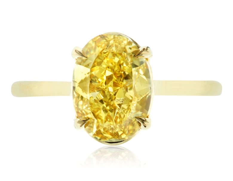Fancy Intense yellow diamond ring of 3.08 carats with GIA report. 1 oval modified brilliant-cut Fancy Intense yellow diamond measuring 10.01 x 7.33 x 5.12 mm and weighing 3.08 carats. Estimate $18,000-22,000. Offered in  Jewels Online Summer Sparkle, 12-27 August 2020, online