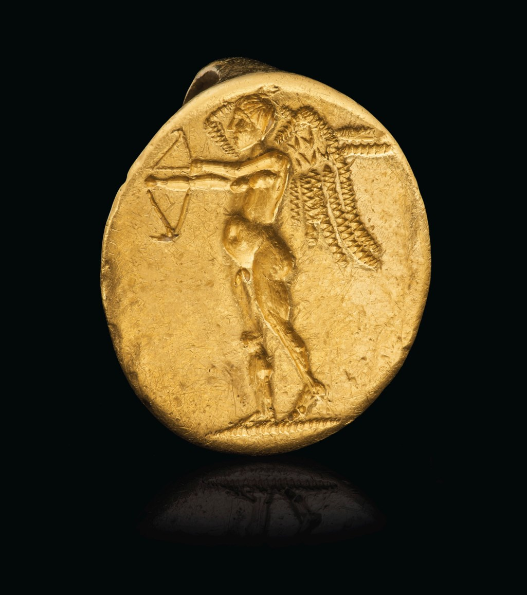 A GREEK GOLD FINGER RING WITH EROS