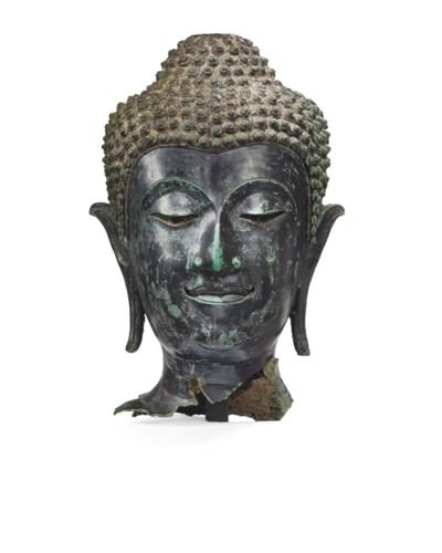 A BRONZE HEAD OF BUDDHA SHAKYA