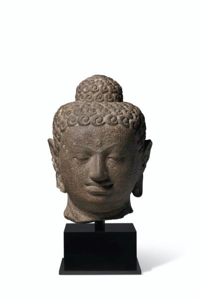 AN ANDESITE HEAD OF BUDDHA