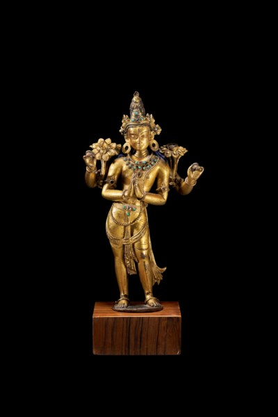 A GILT-COPPER FIGURE OF AVALOK