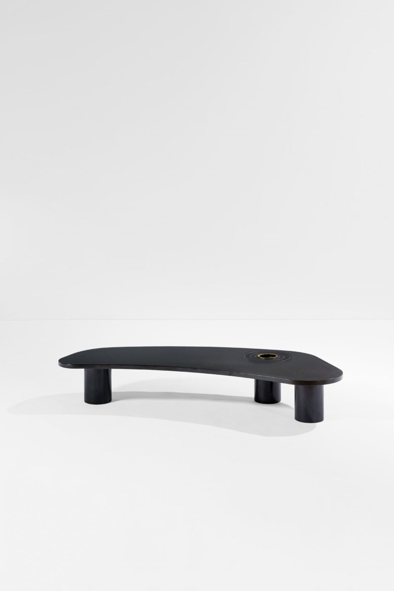Jean Royère (1902-1981), Coffee table Forme libre or Cachalot, the model created before 1958, this one made in 1962. Formica and painted zinc. 25 x 152 x 55.5 cm  9⅞ x 59⅞ x 21⅞ in. Estimate €150,000-200,000. Offered in Design on 30 June 2020 at Christie's in Paris