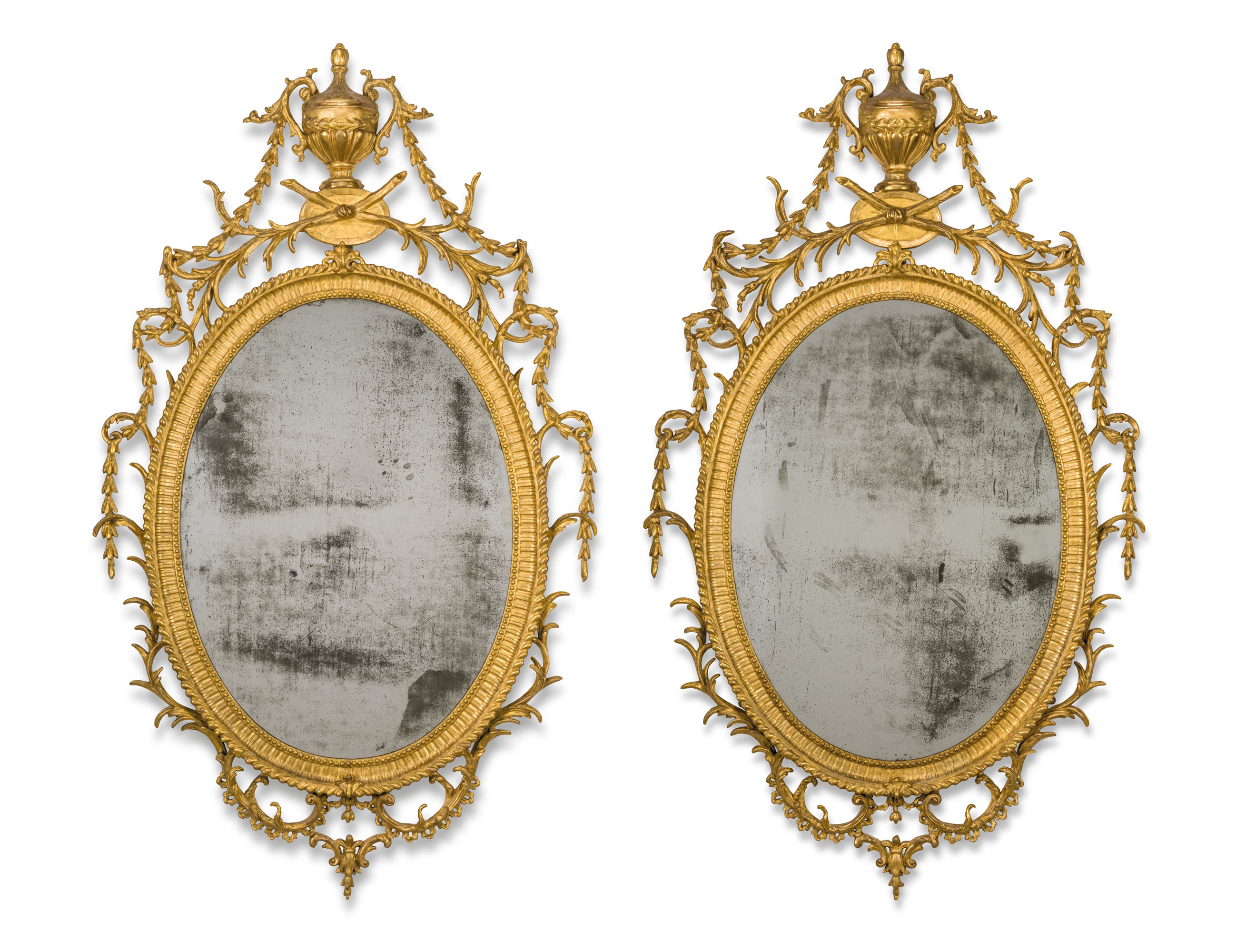 A PAIR OF GEORGE III GILTWOOD AND CARTON PIERRE OVAL MIRRORS