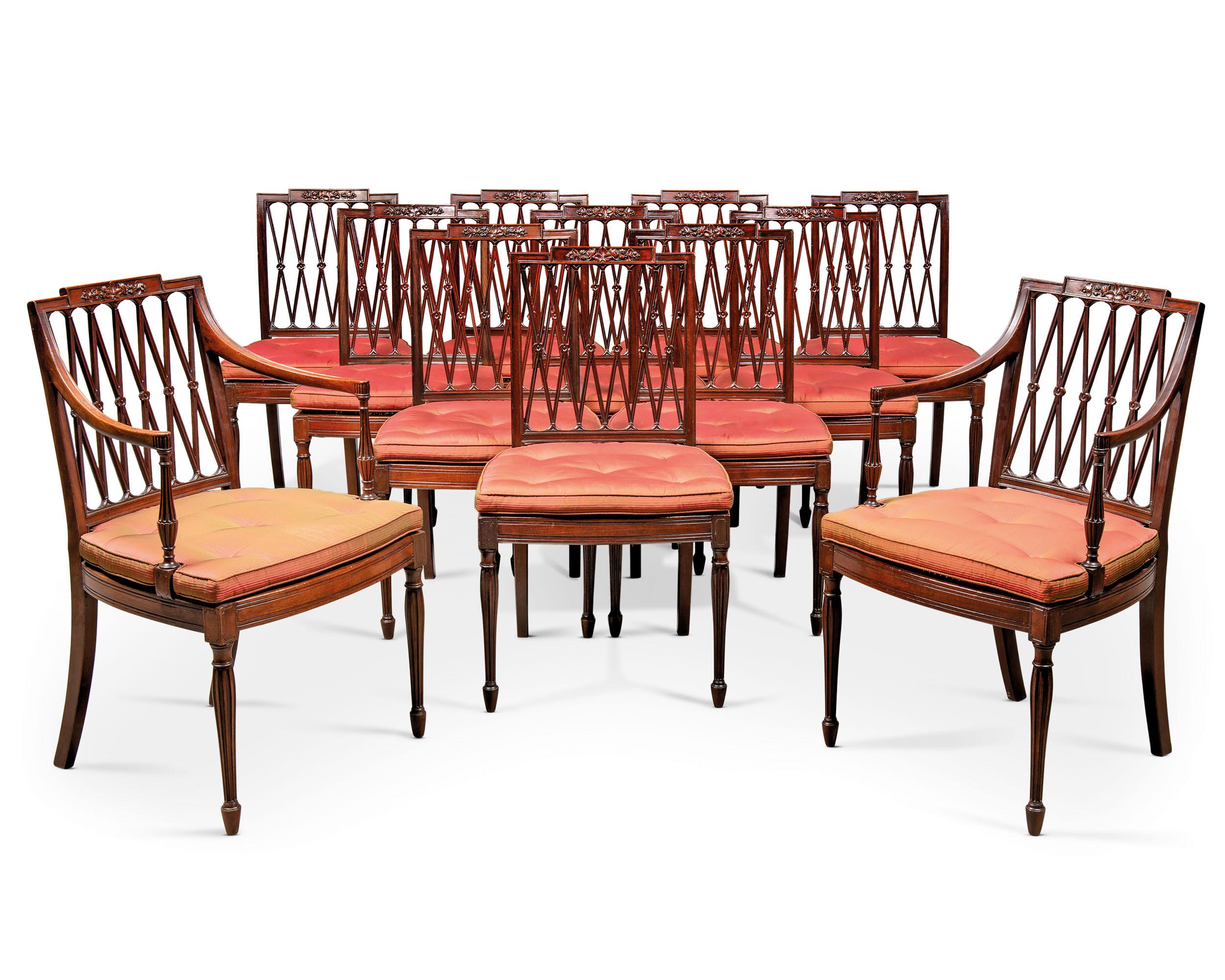 A SET OF TWELVE GEORGE III MAHOGANY DINING-CHAIRS