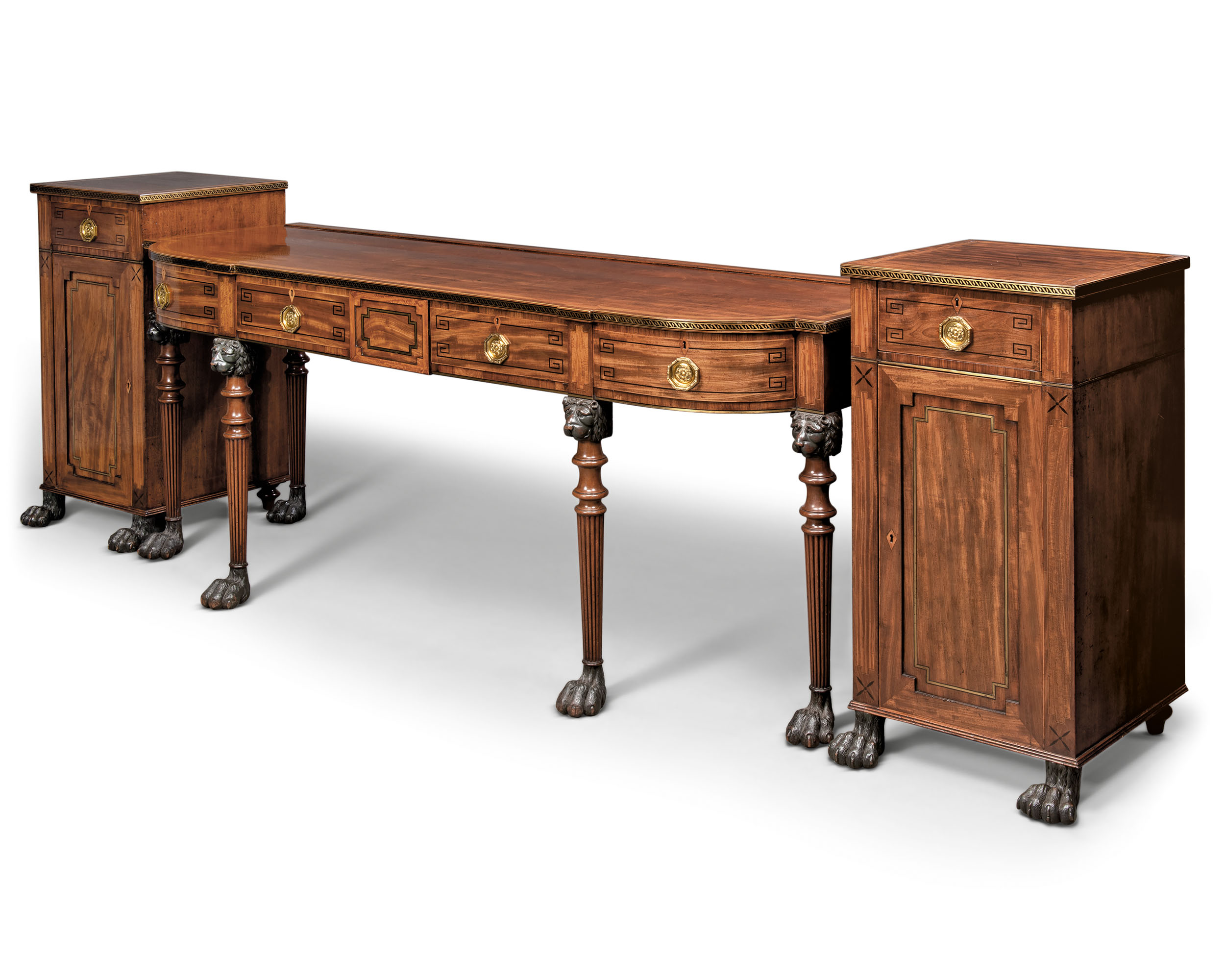 A REGENCY BRASS-INLAID MAHOGANY, EBONY, EBONISED AND SATINWOOD-CROSSBANDED SERVING-TABLE AND PAIR OF PEDESTALS