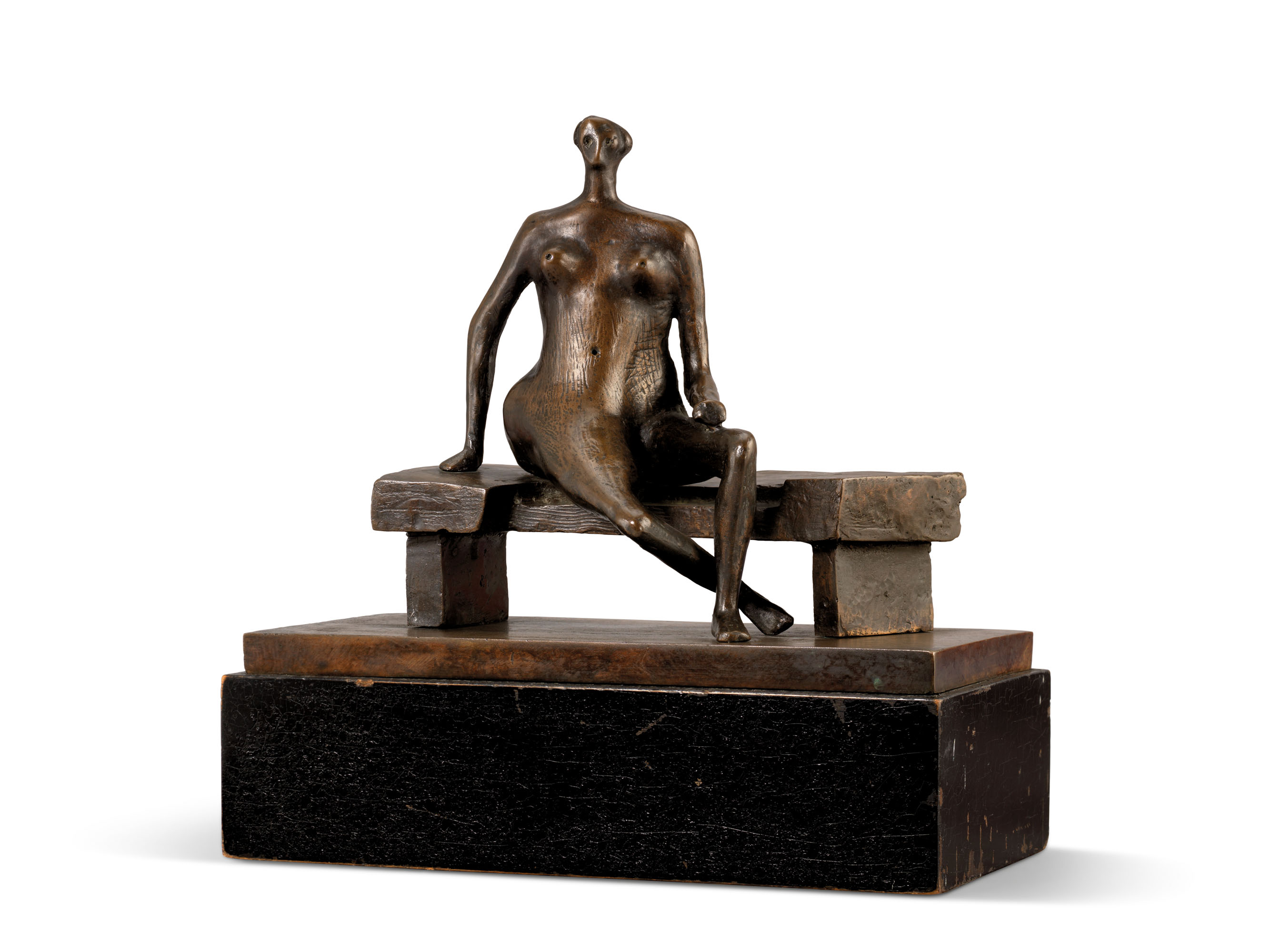 Henry Moore (1898-1986),Seated Woman with Crossed Feet, conceived in 1957 and cast in 1965. Bronze with a dark brown patina, on a black-painted wooden base. 9½ in. (24.1 cm) wide, excluding base. Estimate £150,000-250,000. Offered inModern British Art Day Saleon 2 March at Christie's inLondon