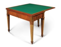 A PAIR OF GERMAN ORMOLU AND BRASS-MOUNTED MAHOGANY MECHANICAL GAMES TABLE