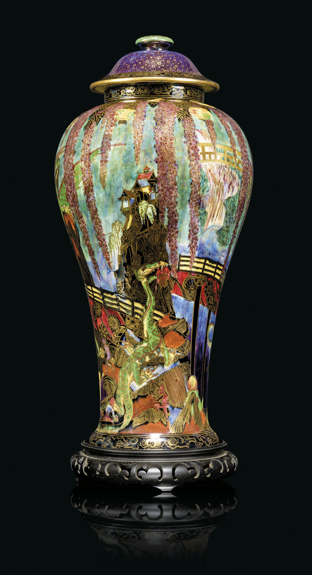 A large Wedgwood Fairyland Lustre 'Temple on a Rock' vase and cover, circa 1925. 20¼ in (51.5 cm) high overall. Estimate £15,000-20,000. Offered in The Collector Live on 19 May 2021 at Christie's in London