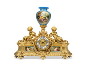 A LARGE FRENCH ORMOLU AND SEVRES-STYLE BLUE-GROUND PORCELAIN