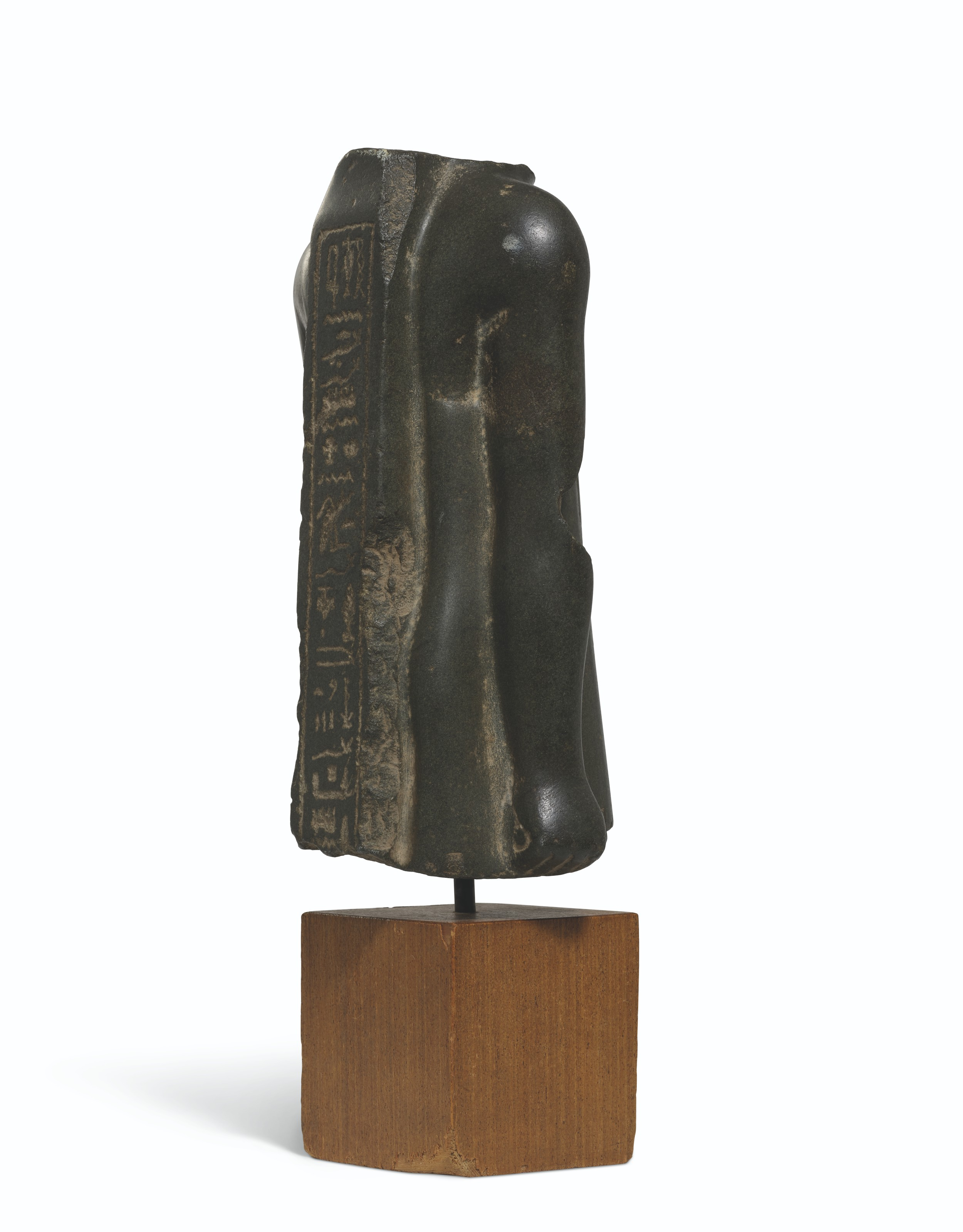AN EGYPTIAN POLYCHROME LIMESTONE RELIEF FRAGMENT