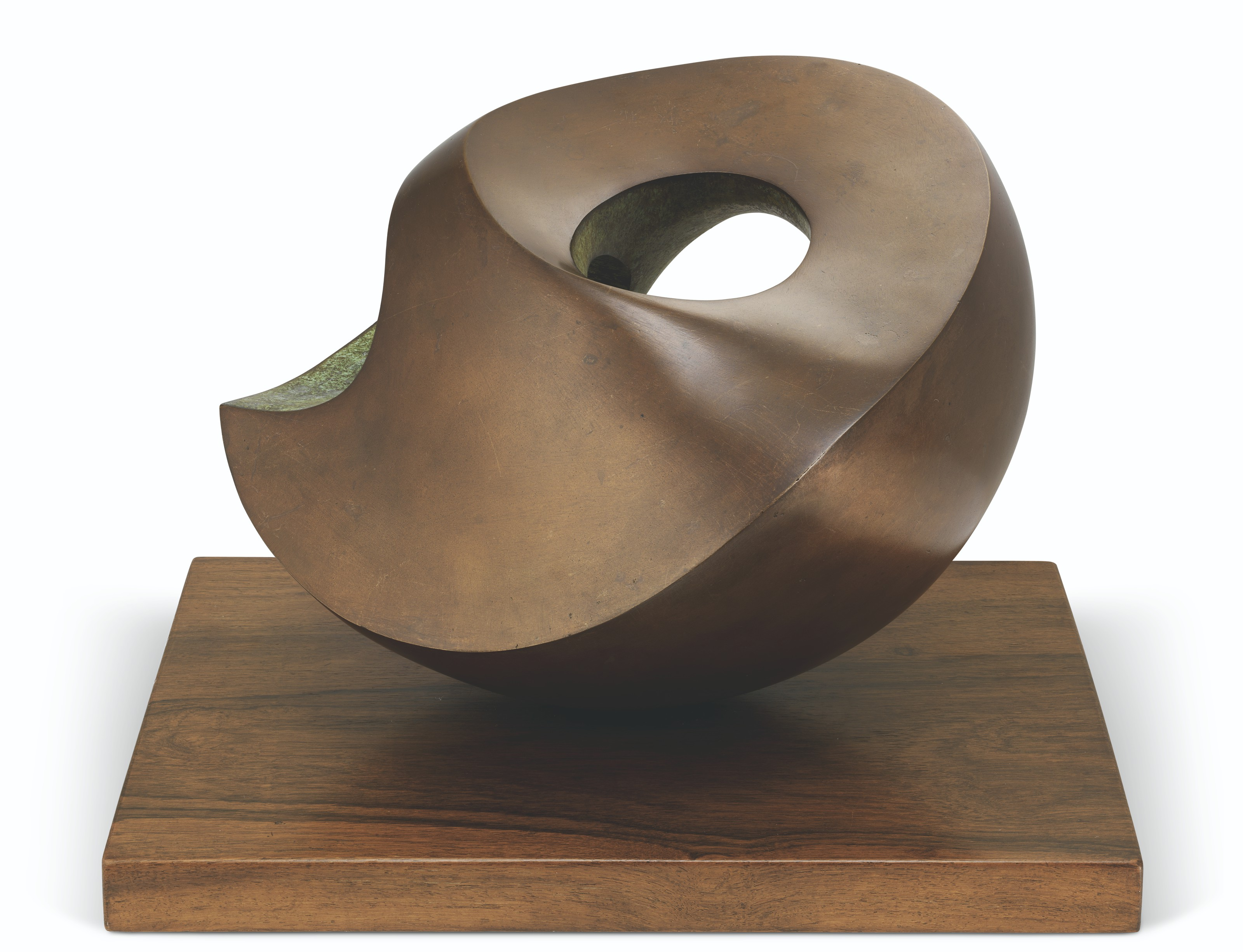 Dame Barbara Hepworth (1903-1975), Involute, 1968. Bronze with a brown and green patina, on a hardwood base. 9⅞  in (25.1  cm) wide, excluding the base. Estimate £120,000-180,000. Offered in Modern British and Irish Art Evening Sale on 20 October 2021 at Christie's in London