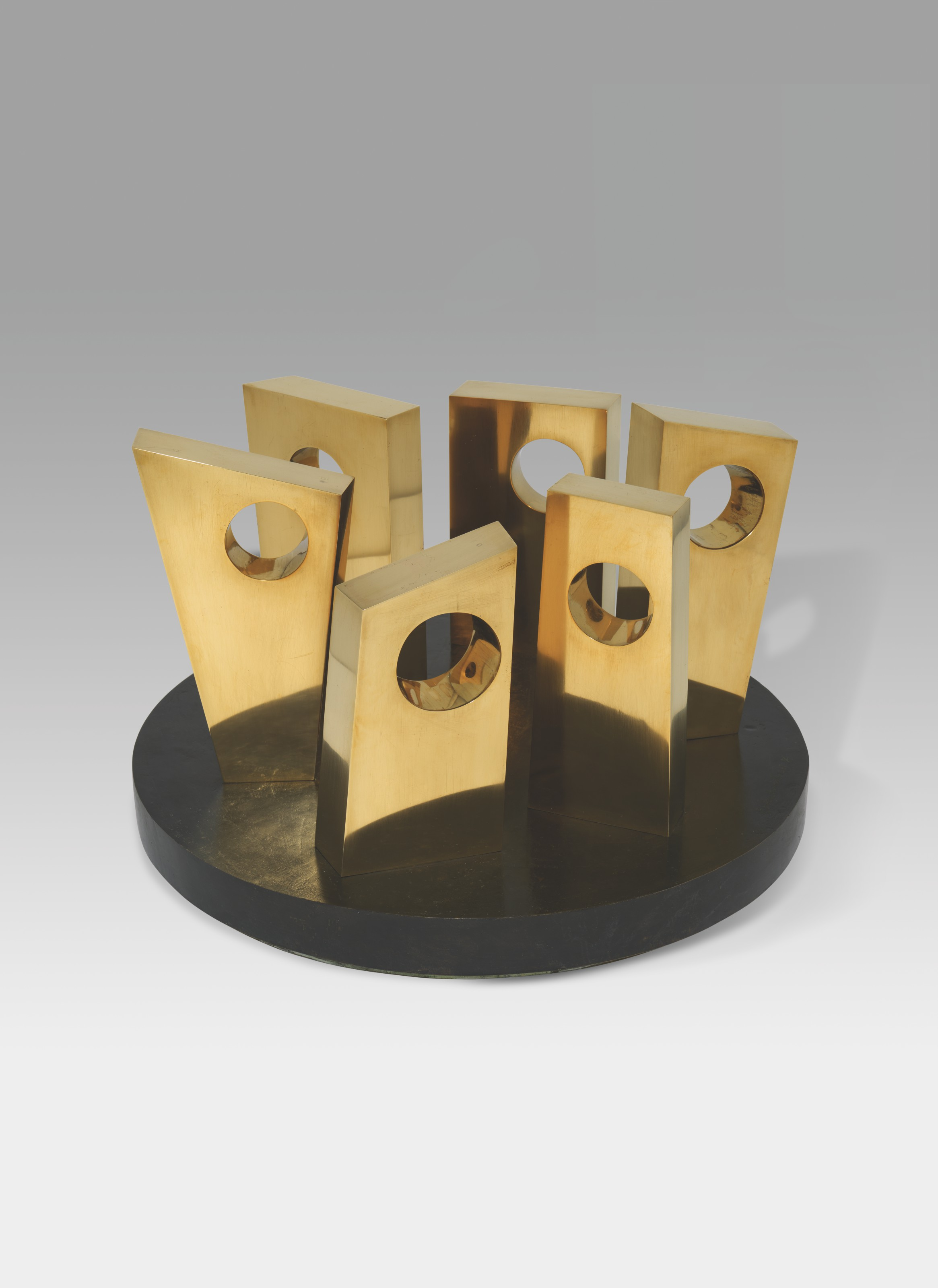 Dame Barbara Hepworth (1903-1975), Six forms on a circle, 1968. Polished bronze on a revolving base. 23¾  in (60.4  cm) wide, including revolving bronze base. Estimate £300,000-500,000. Offered inModern British and Irish Art Evening Saleon 20 October 2021 at Christie's in London
