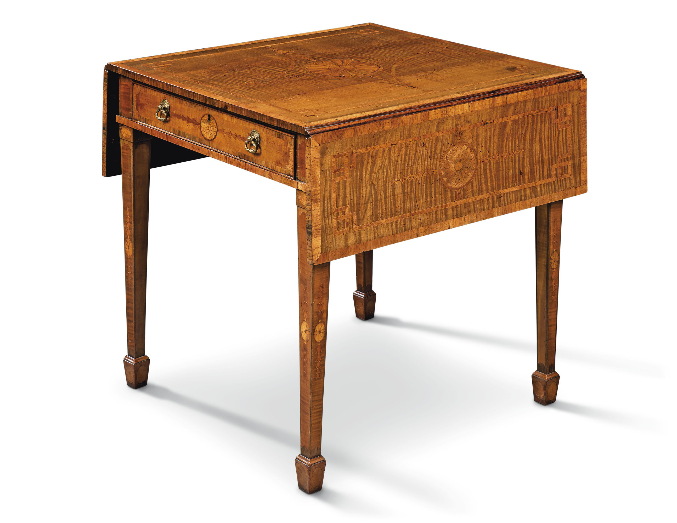 A George III tulipwood-crossbanded, harewood, Indian rosewood and fruitwood marquetry Pembroke table, attributed to Thomas Chippendale, circa 1770.27 in (69 cm) high; 24½ in (62 cm) wide (closed); 26 in (66 cm) deep. Estimate £20,000-40,000.Offered inThe Collection of Mrs. Henry Ford II Eaton Square and Turville Grangeon 15 April at Christie's in London