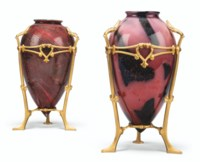 TWO GILT-COPPER 'HARNESSED' GLASS VASES