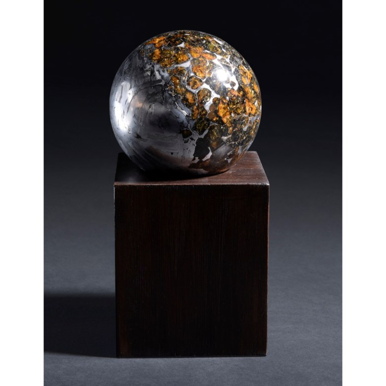 An extraterrestrial crystal ball — transitional Seymchan meteorite sphere, pallasite PMG—Magadan district, Russia. 3 in (7.6 cm) diameter. Estimate £50,000-80,000. Offered in Science and Natural History, 12-26 October 2021 at Christie's Online