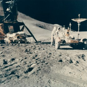 Two views of Astronaut James Irwin servicing the lunar rover