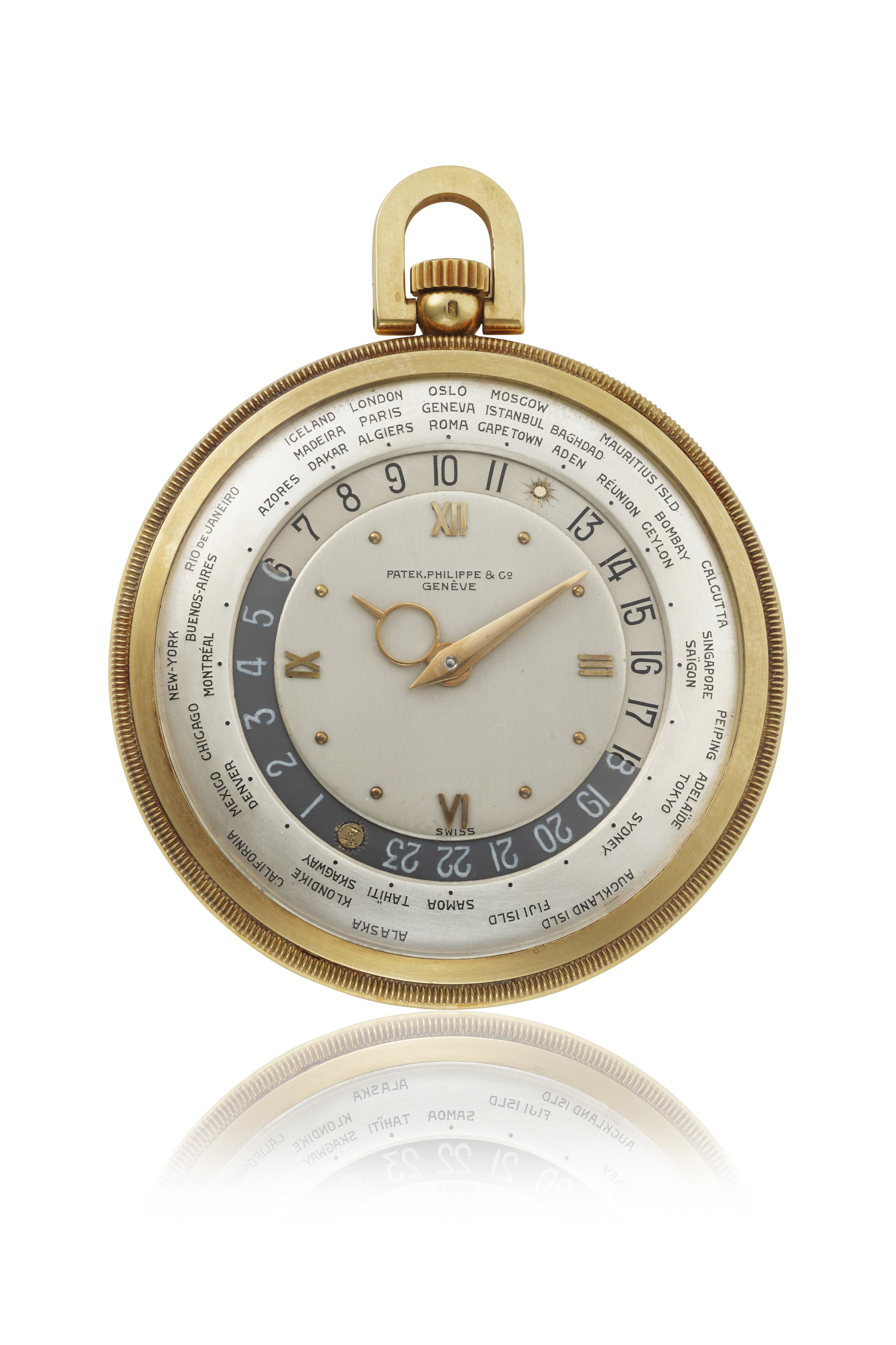 Patek Philippe, a fine and rare 18k gold open-face keyless lever World Time watch with later engraved coat of arms, 1944. Sold for CHF 137,500 on 10 May 2021 at Christie's in Geneva