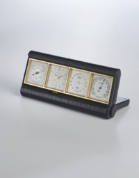 ANGELUS, RETAILED BY HERMES. AN UNSUAL GILT METAL AND LEATHER HIINGED DESK TIMEPIECE WITH WEATHER STATION, TRIPLE CALENDAR AND ALARM