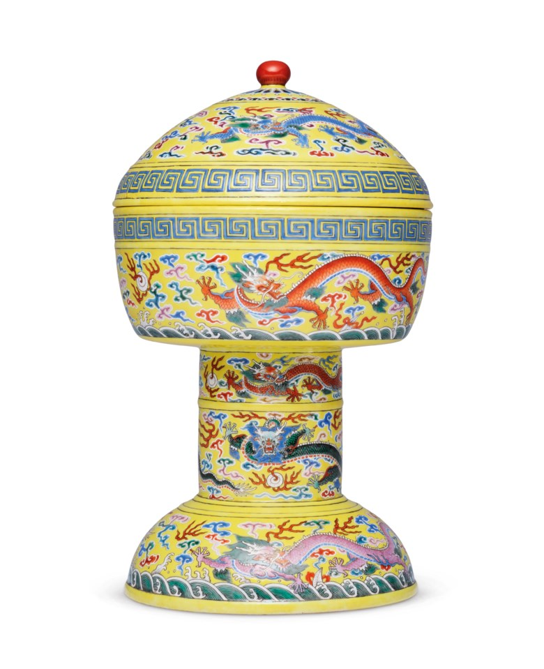 A very rare famille rose lemon yellow-ground 'nine-dragon' deng and cover. Qianlong impressed six-character seal marks and of the period (1736-1795). Sold for HK$11,050,000 on 28 May 2021 at Important Chinese Ceramics and Works of Art