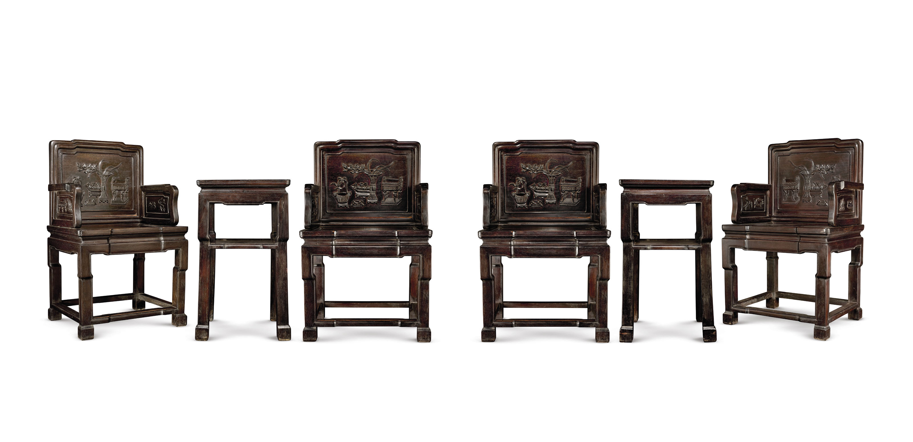 A SET OF FOUR CARVED HARDWOOD ARMCHAIRS AND TWO SQUARE SIDE TABLES