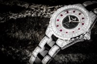CHANEL. AN IMPRESSIVE AND EXTREMELY RARE 18K WHITE GOLD, BLACK CERAMIC, BAGUETTE-CUT DIAMOND AND RUBY-SET LIMITED EDITION AUTOMATIC WRISTWATCH WITH SWEEP CENTRE SECONDS
