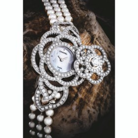 CHANEL A LADY'S VERY ATTRACTIVE 18K WHITE GOLD, DIAMOND AND