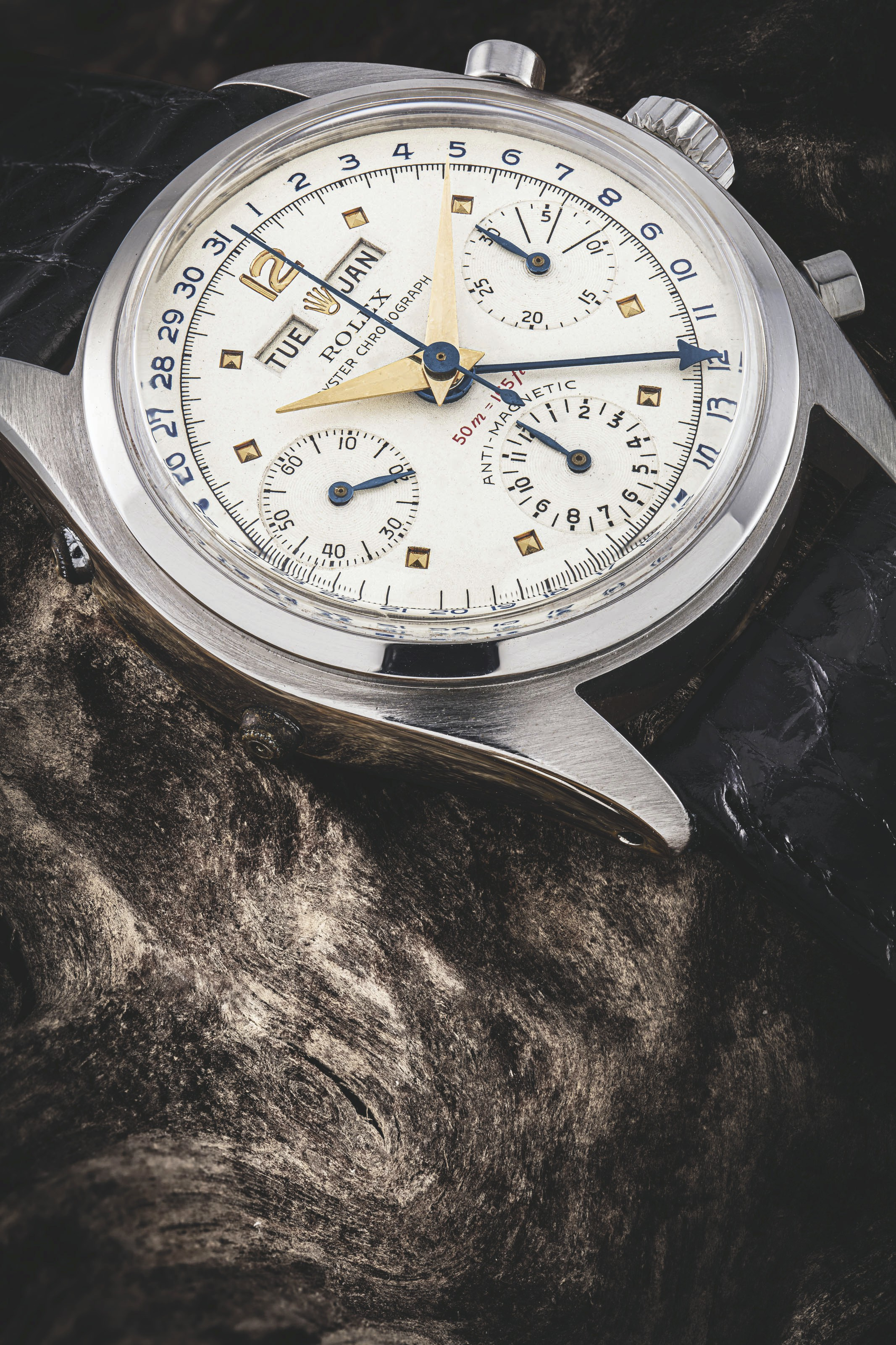 """Rolex. An extremely rare stainless steel chronograph triple calendar wristwatch, Ref. 6036, """"Jean Claude Killy"""" model with """"red depth"""", circa 1953. Auction Record for the Reference. Sold for HK$5,250,000 on 22 May 2021 at An Exceptional Season of Watches"""