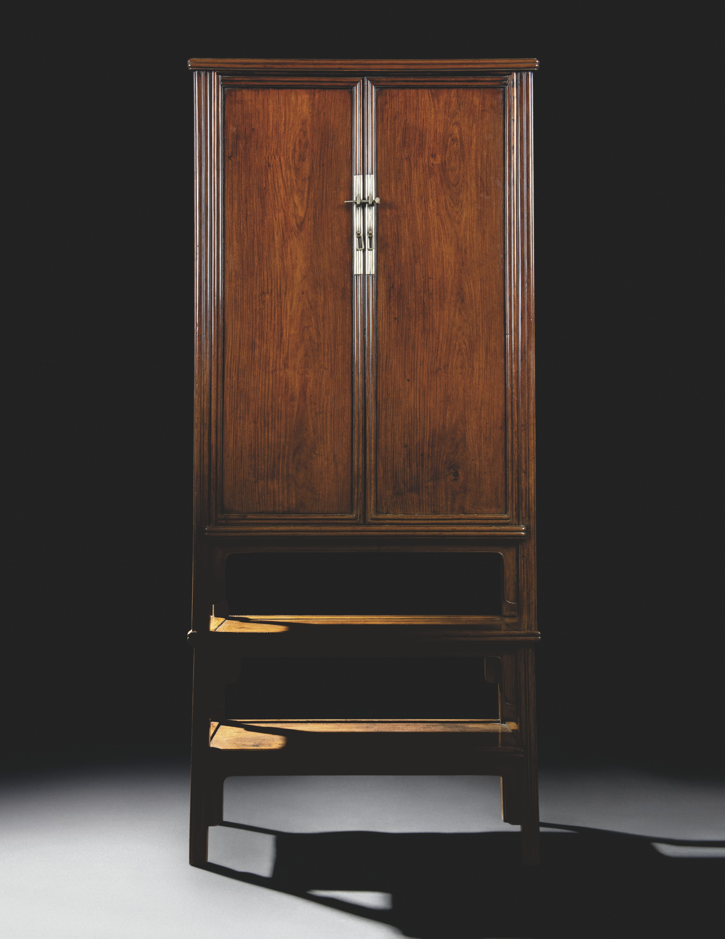 A VERY RARE HUANGHUALI ROUND-CORNER TAPERED CABINETS AND STAND, YUANJIAOGUI