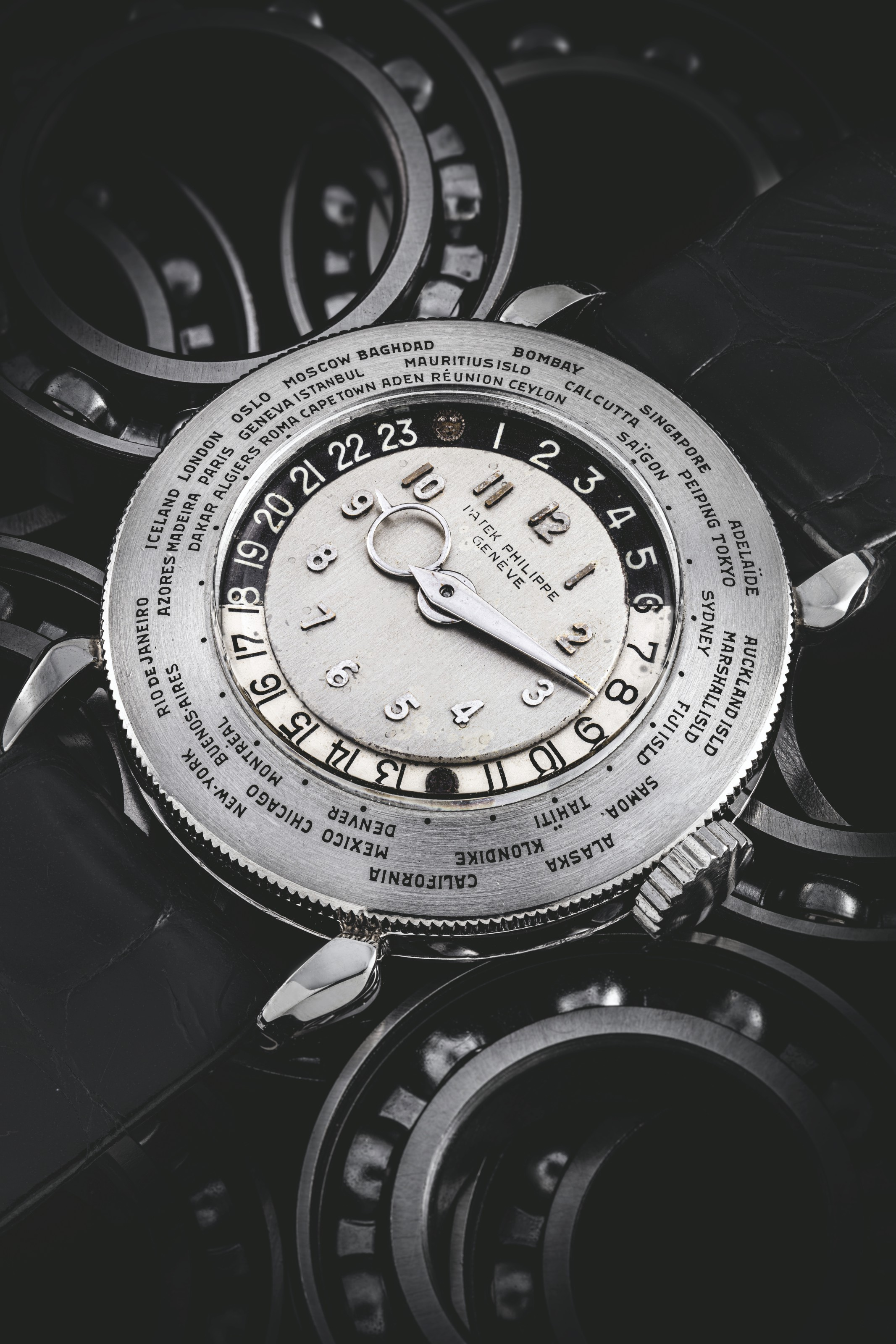 PATEK PHILIIPPE. A UNIQUE AND VERY IMPORTANT PLATINUM WORLD TIME WRISTWATCH