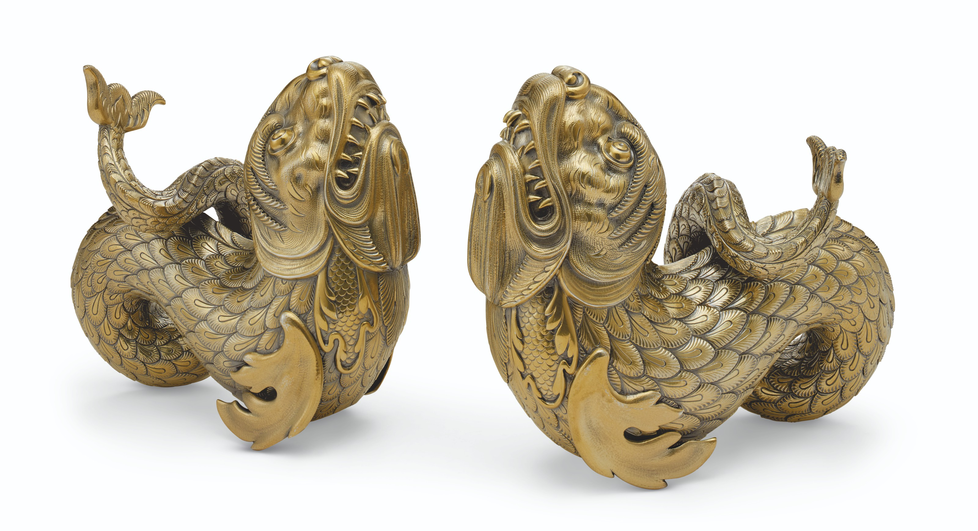 A PAIR OF SILVER-GILT FIGURES OF DOLPHINS