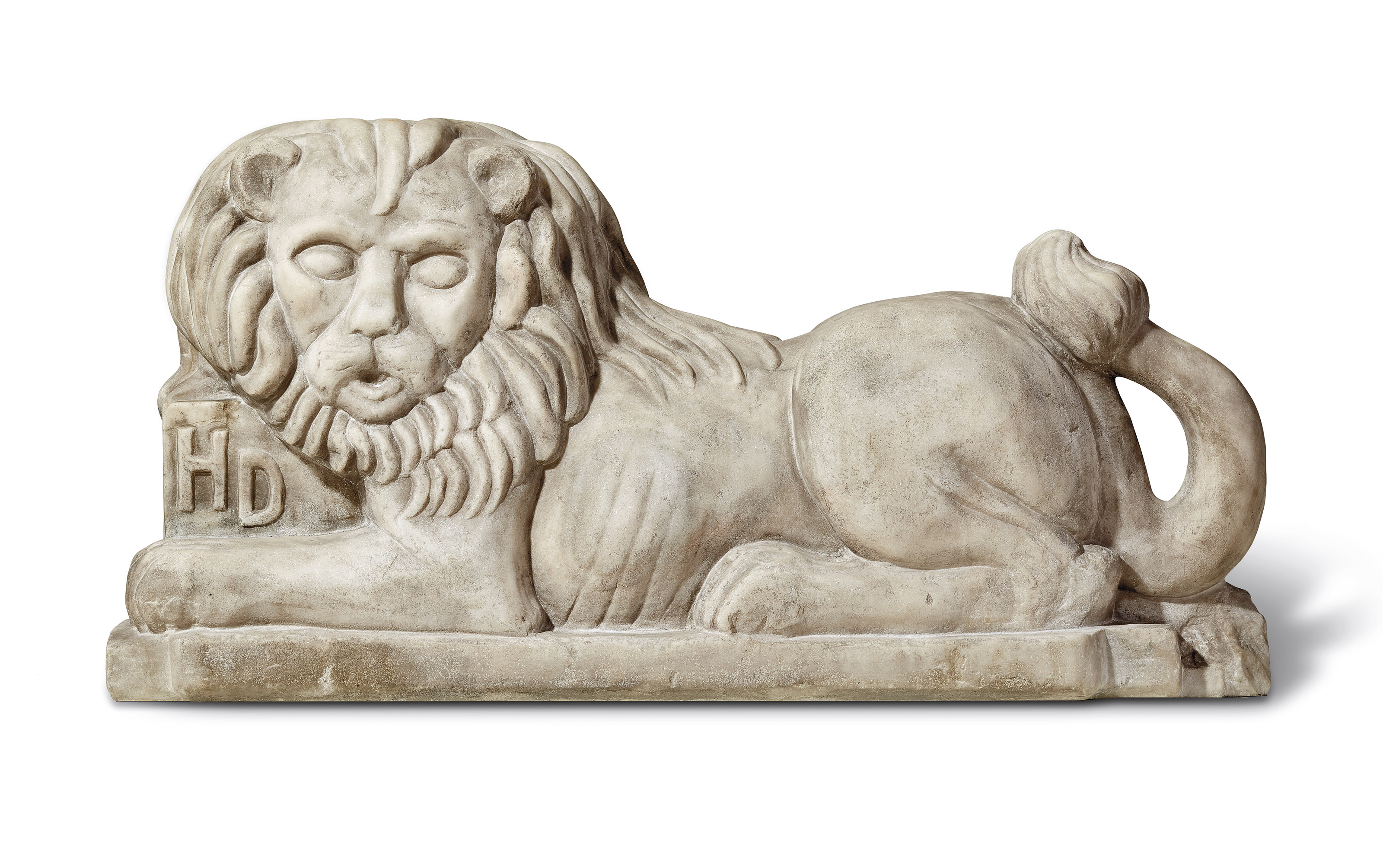 A CARVED WHITE MARBLE RECUMBENT LION