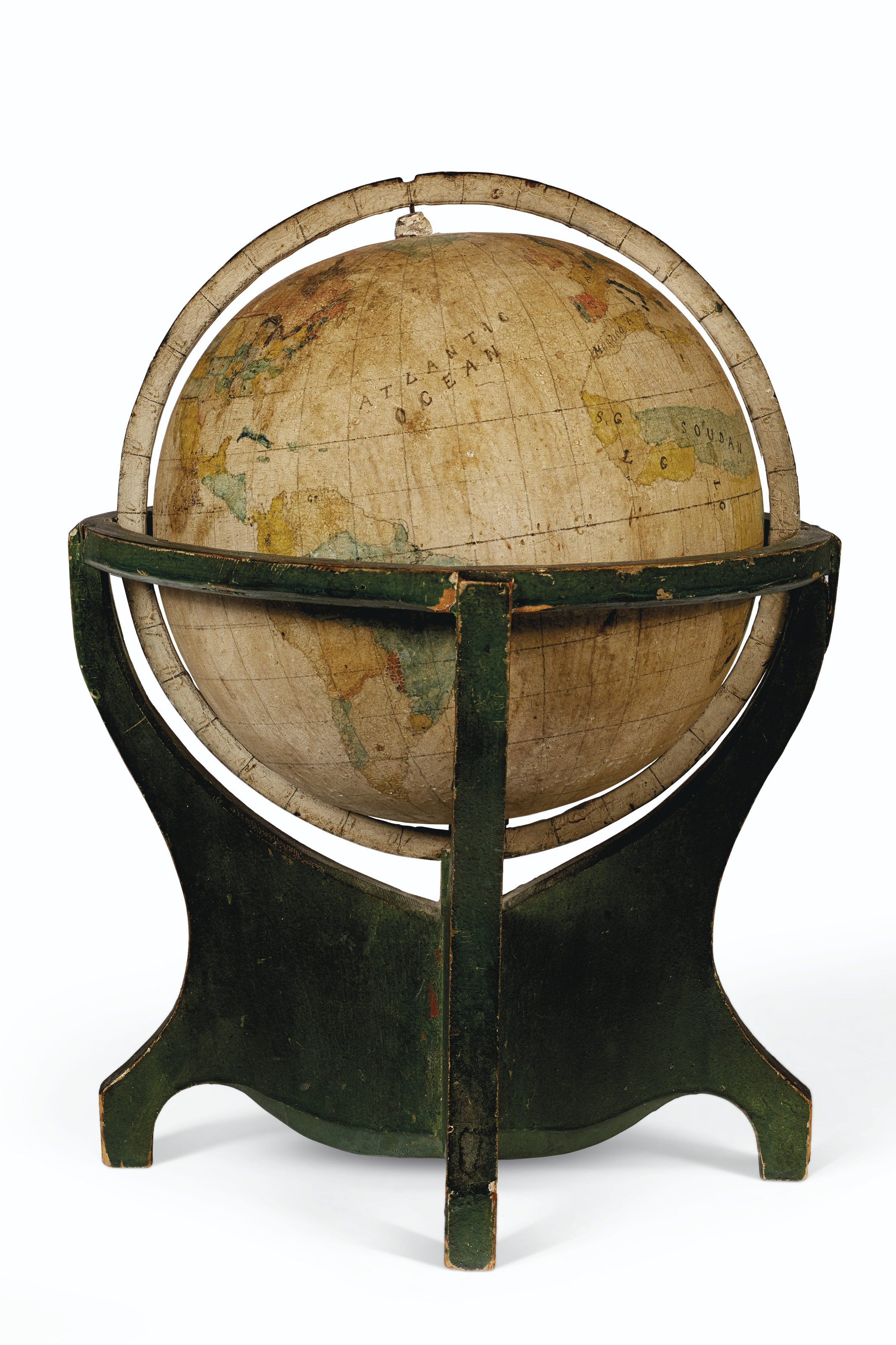 A SMALL PAINTED METAL GLOBE IN WOOD STAND