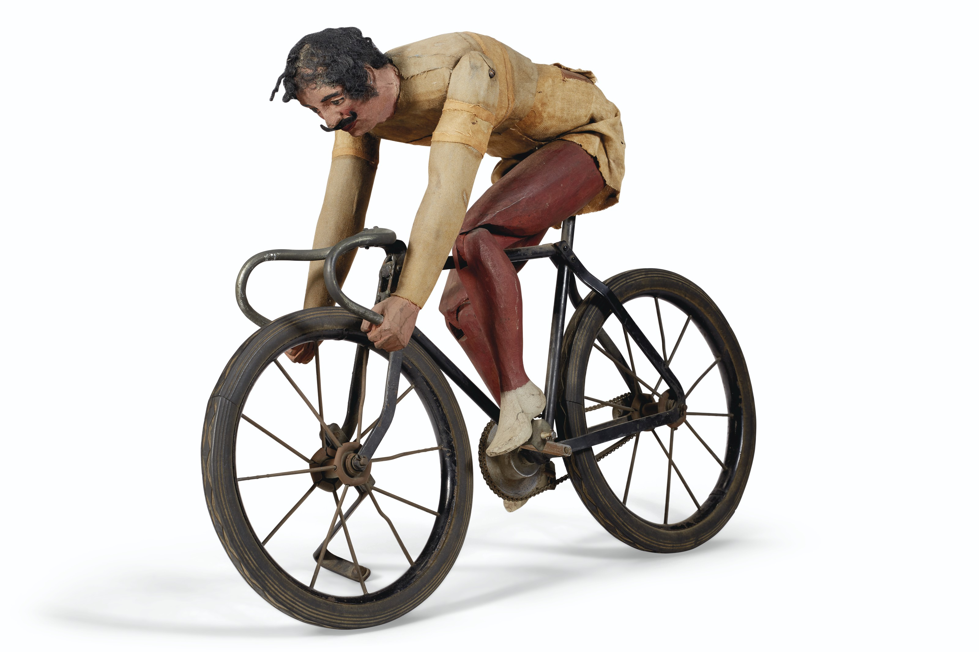 AN ARTICULATED PAINTED PINE AND FABRIC CYCLIST
